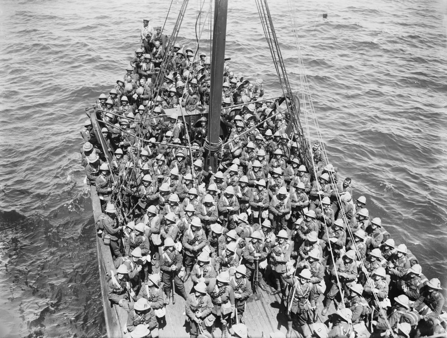 Soldiers of the Lancashire Fusiliers, 29th Division, are seen on board an old Royal Navy battleship used in the third phase of operations in the Dardanelles Straits before they disembarked at 'W' and 'V' beaches off Cape Helles on 5 May 1915