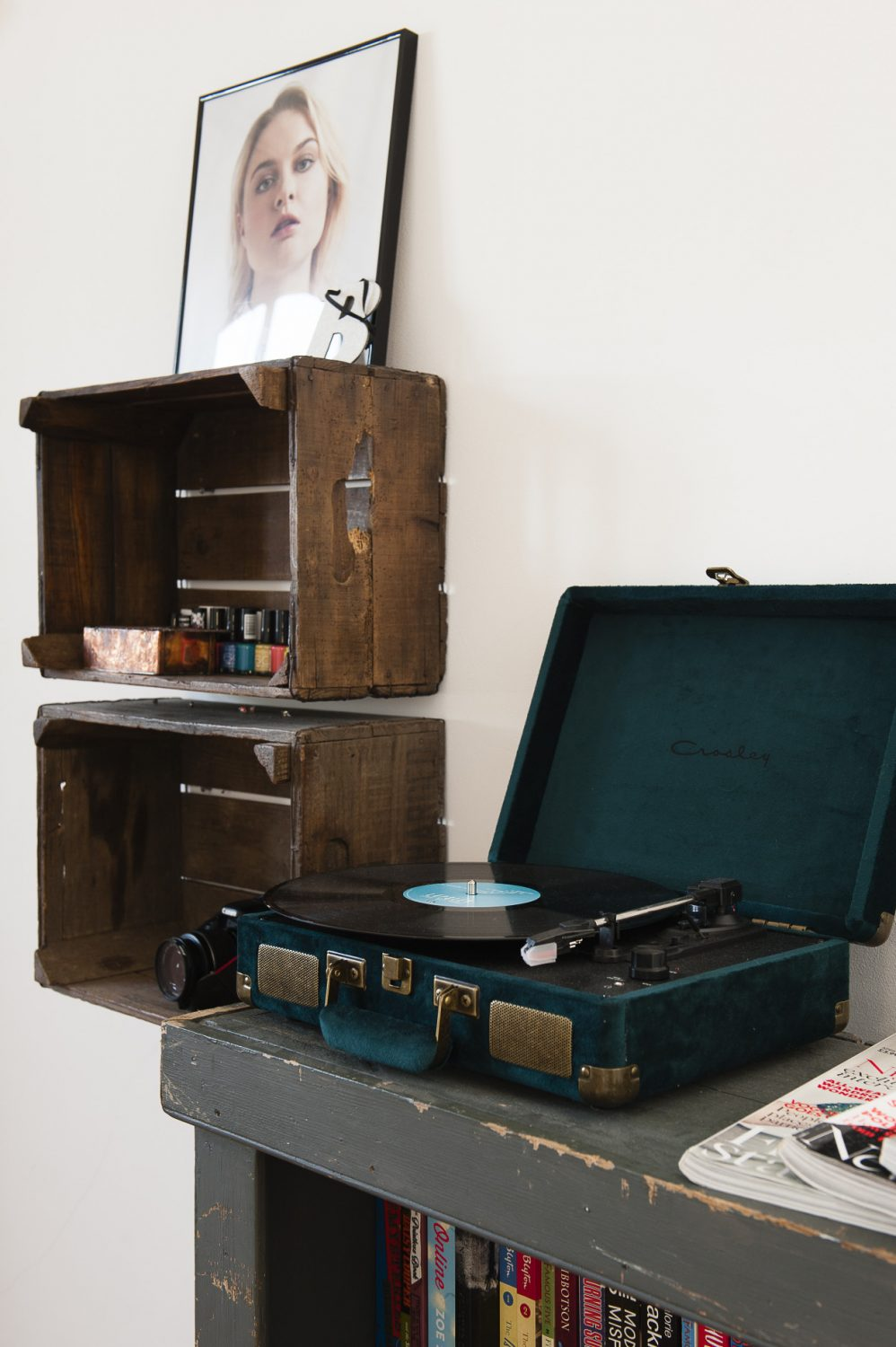 In their daughter's bedroom, Stuart created shelves out of old apple crates. Her vintage turntable sits on an old bookshelf from Rye vintage market