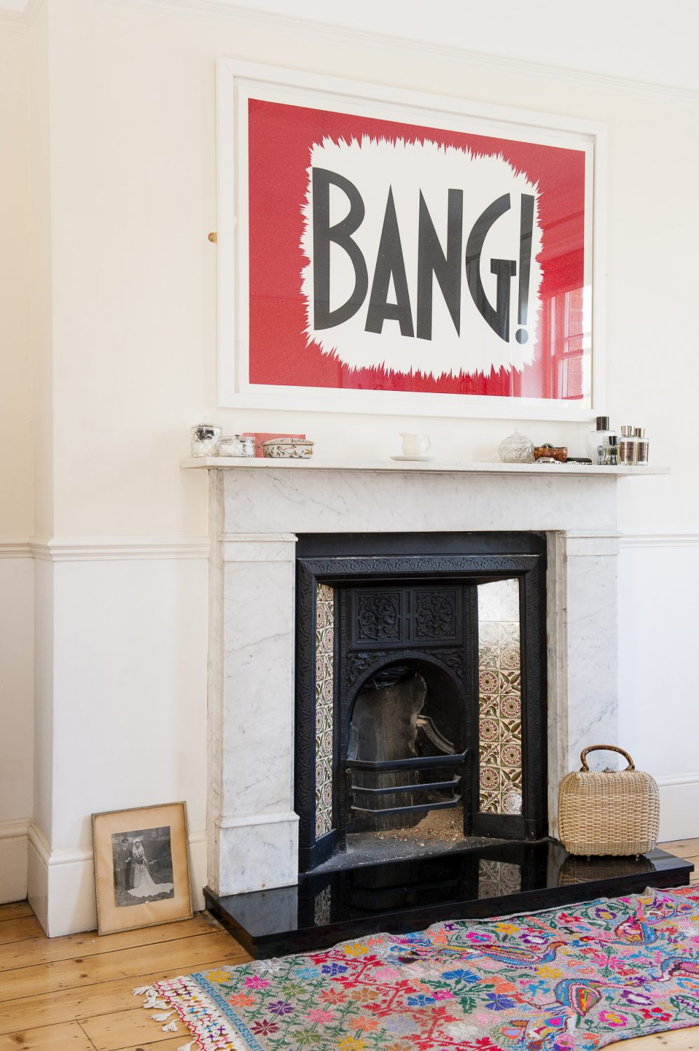 The framed Bang! poster in the master bedroom is a limited edition print by pop artist William Blanchard