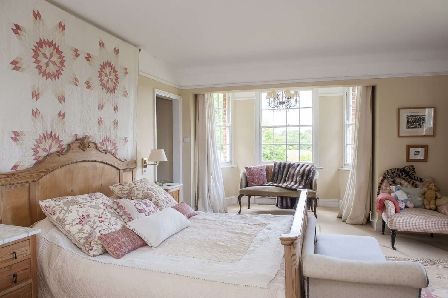 The master bedroom features lovely paisley throws and washed out kilims