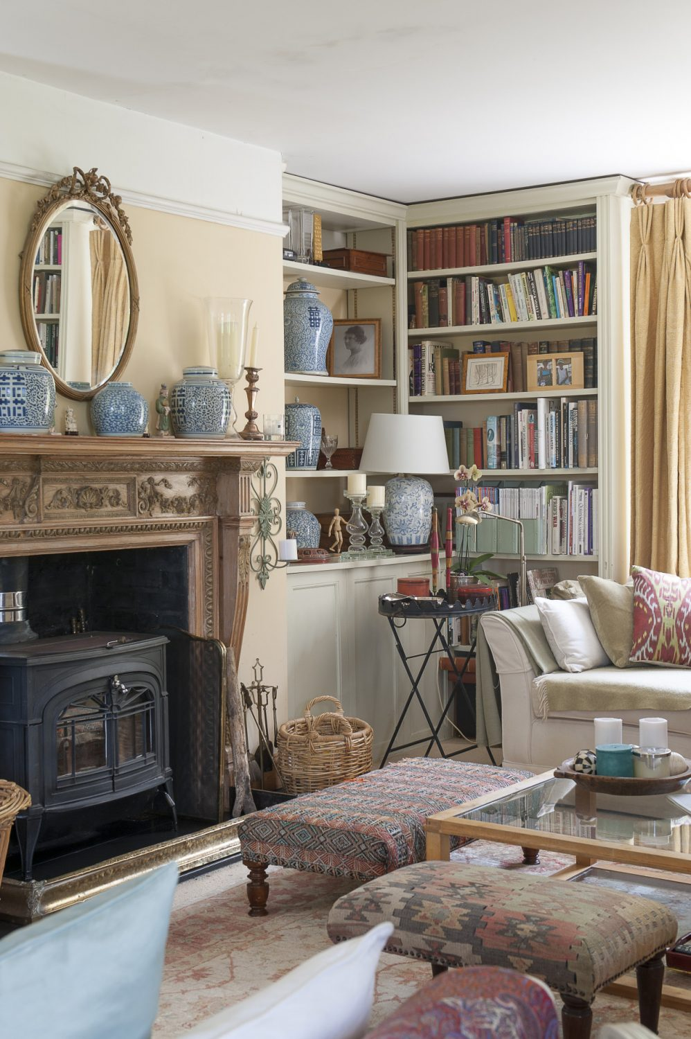 The sitting room is painted and decorated in shades of pale apricot with splashes of a heavenly soft pale green