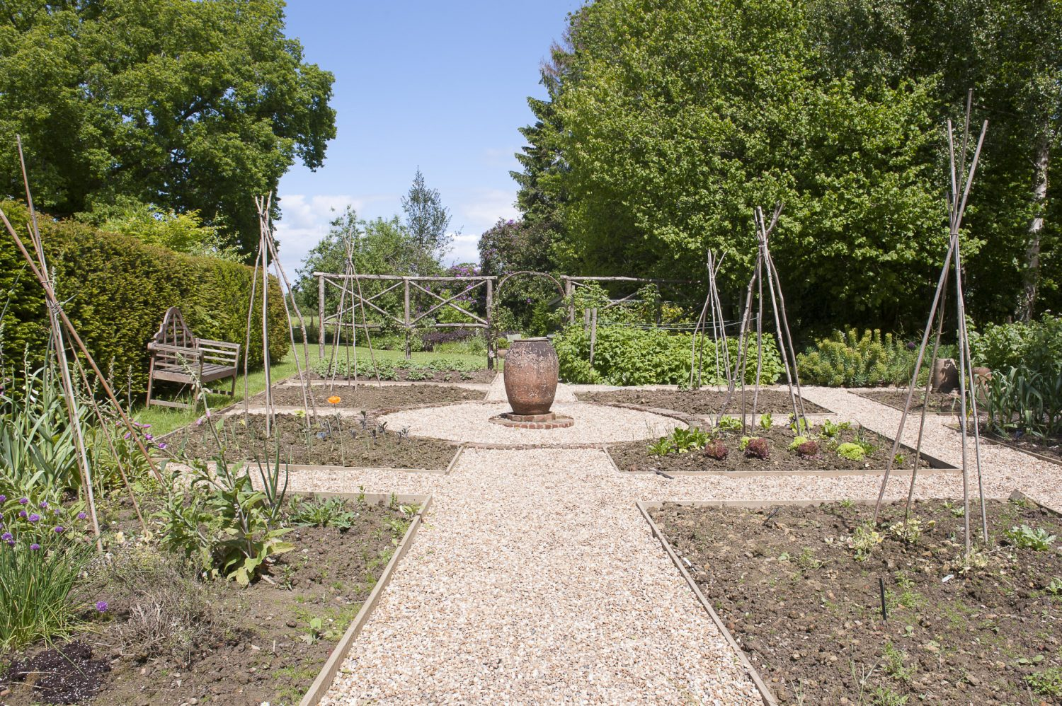 In the recently revamped vegetable garden raised beds are divided by smart gravel paths