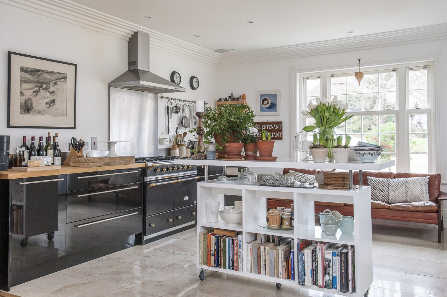 The marble floor tiles were the only feature of the kitchen in place when the Smiths bought their home. They added minimalist off-the-shelf kitchen units and a clever, mobile kitchen unit which can be moved to create more space if necessary