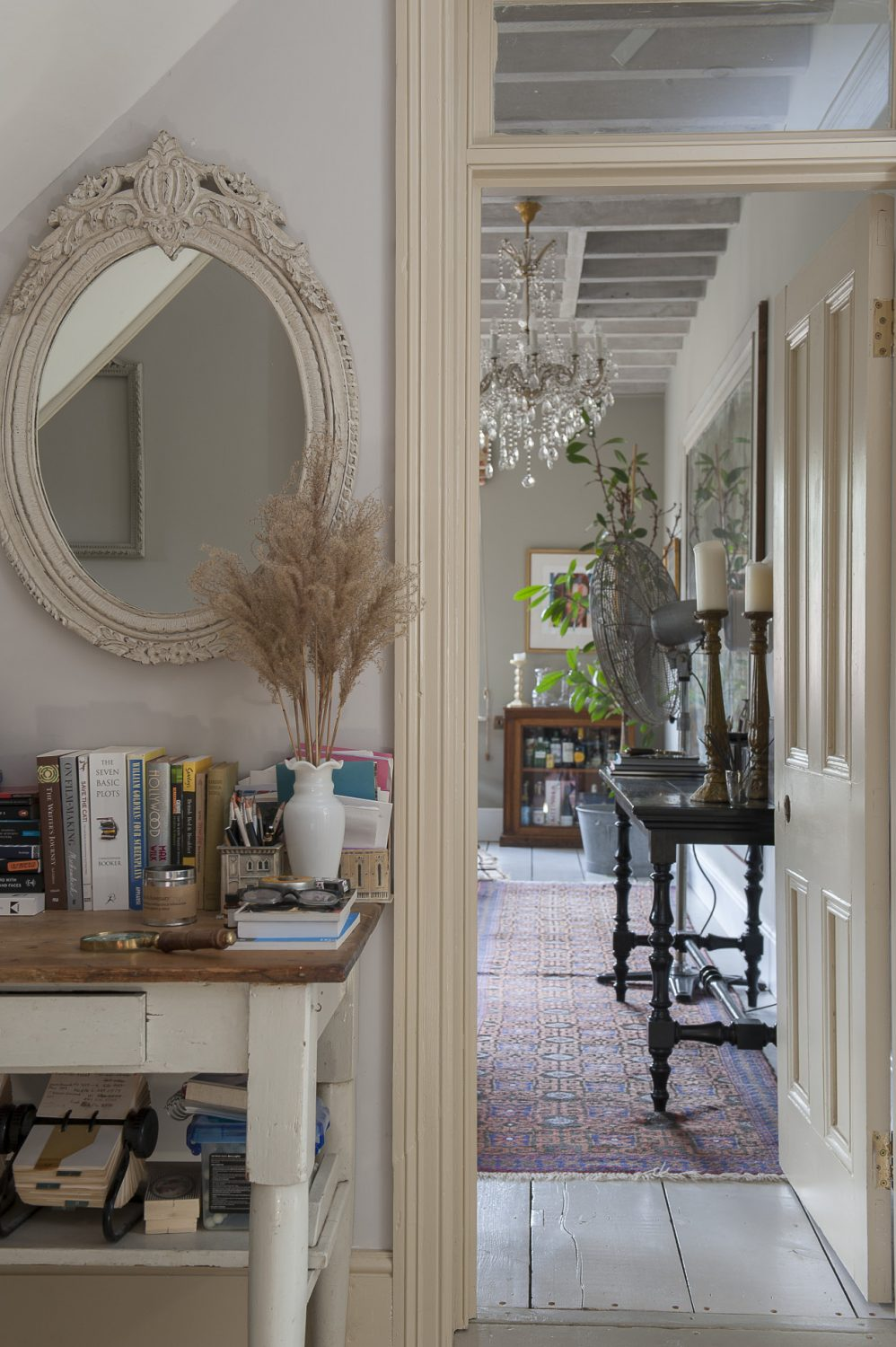 Vintage mirrors, carefully placed, are key to this light and bright home