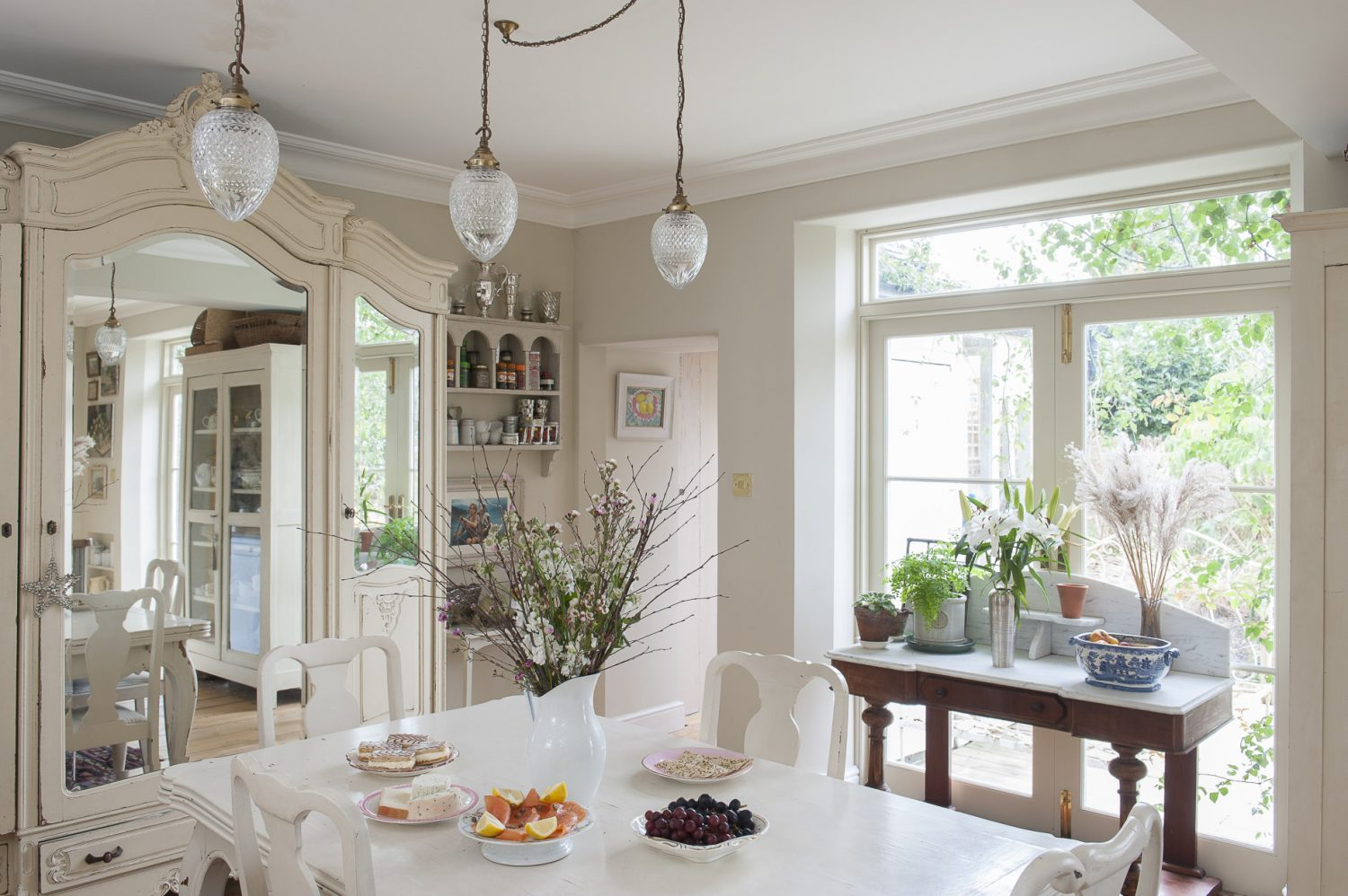 The large open-plan kitchen is a mix of French and Scandinavian style as well as being eminently practical; recycling bins are hidden under the kitchen counter and a double butler sink occupies the central island