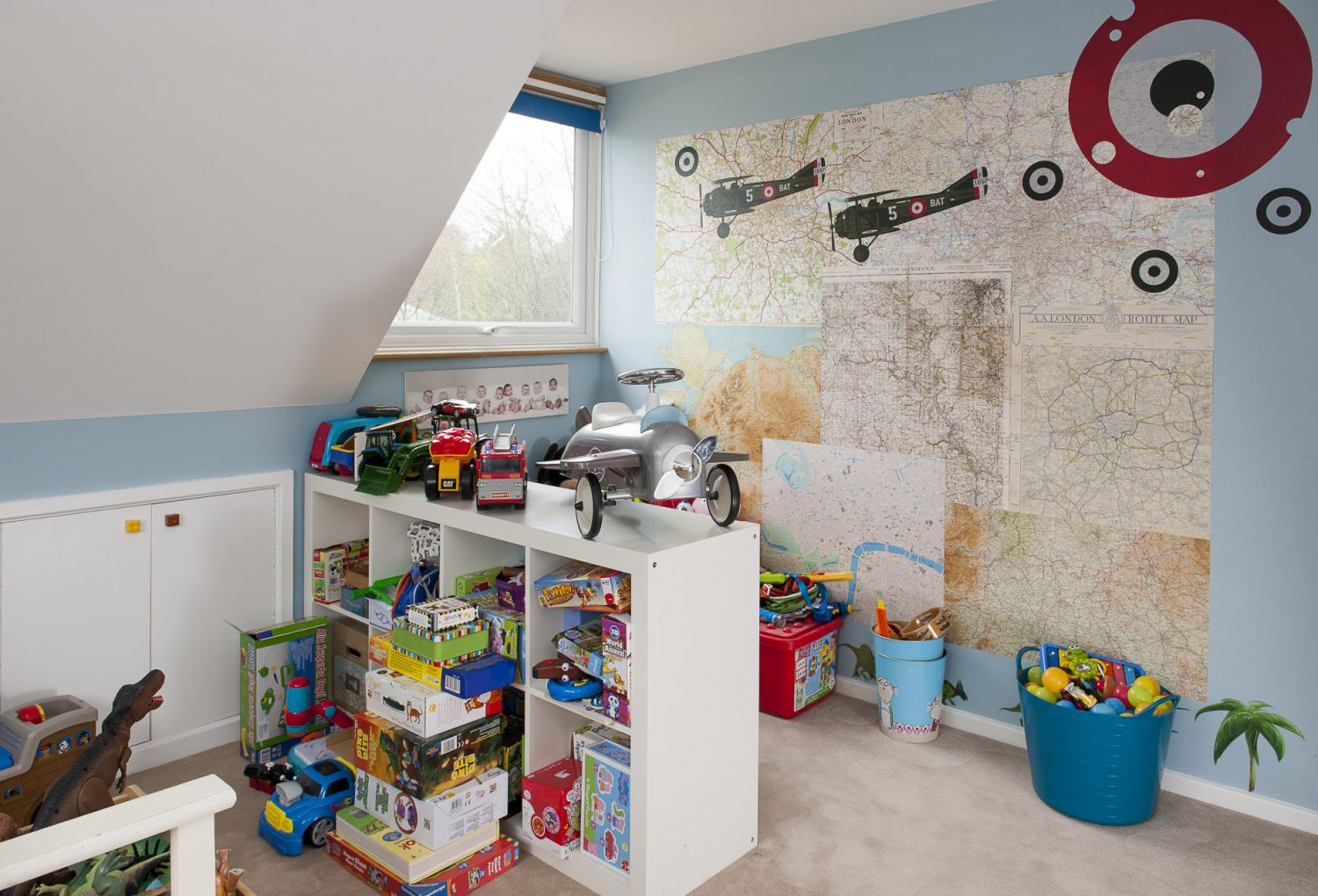 Son William's room features a wall that's papered in old maps, sourced by Sandra from antiques shops and fairs