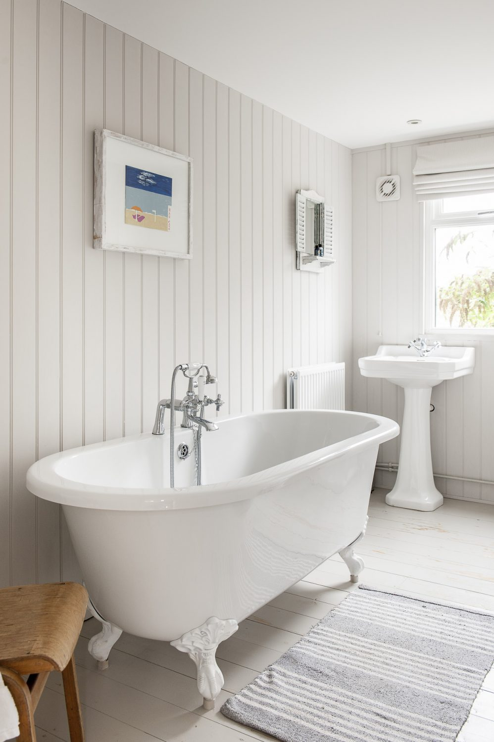 Over the free-standing bath in the in new bathroom is a picture by Francesca's artist uncle, Nick Maddison