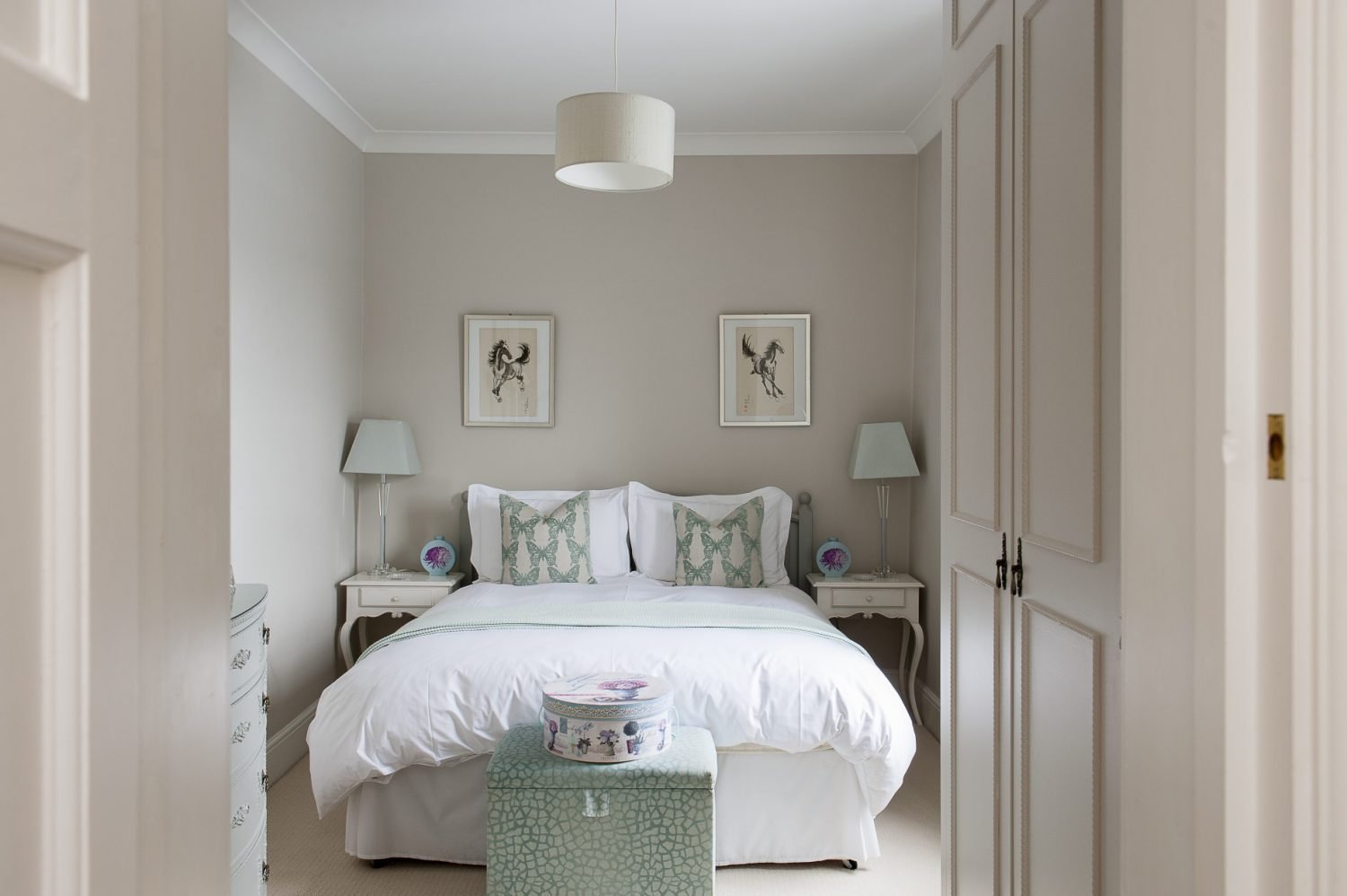 A guest bedroom features accents of robin's egg blue