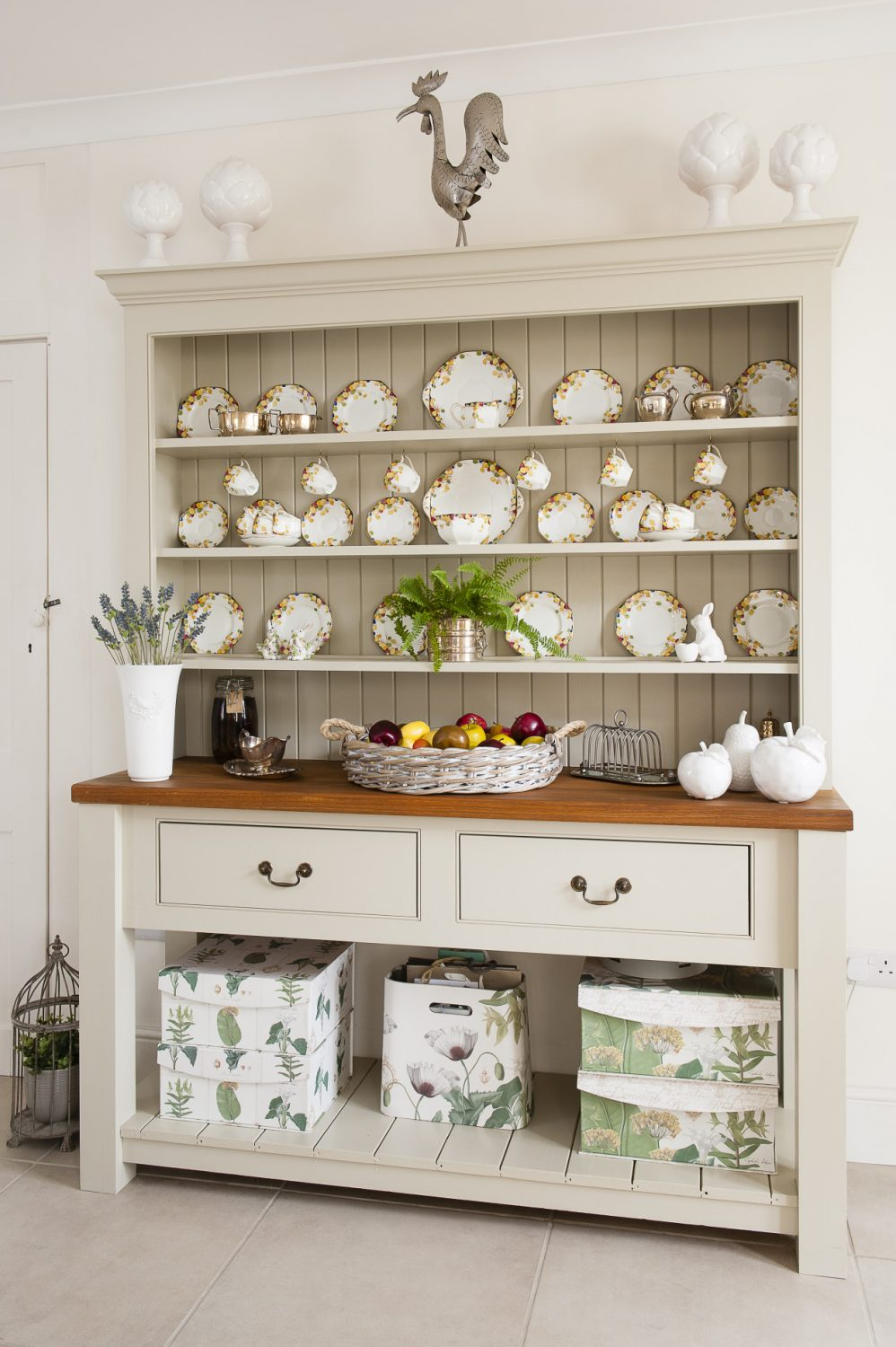 A painted Welsh dresser displays a full set of early 20th century bone china that belonged to Murielle's parents