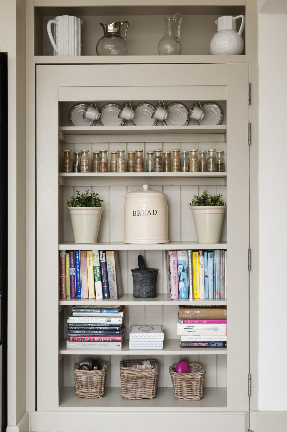 Shelves of cookery books hint at the big family gatherings that Murielle loves to hold