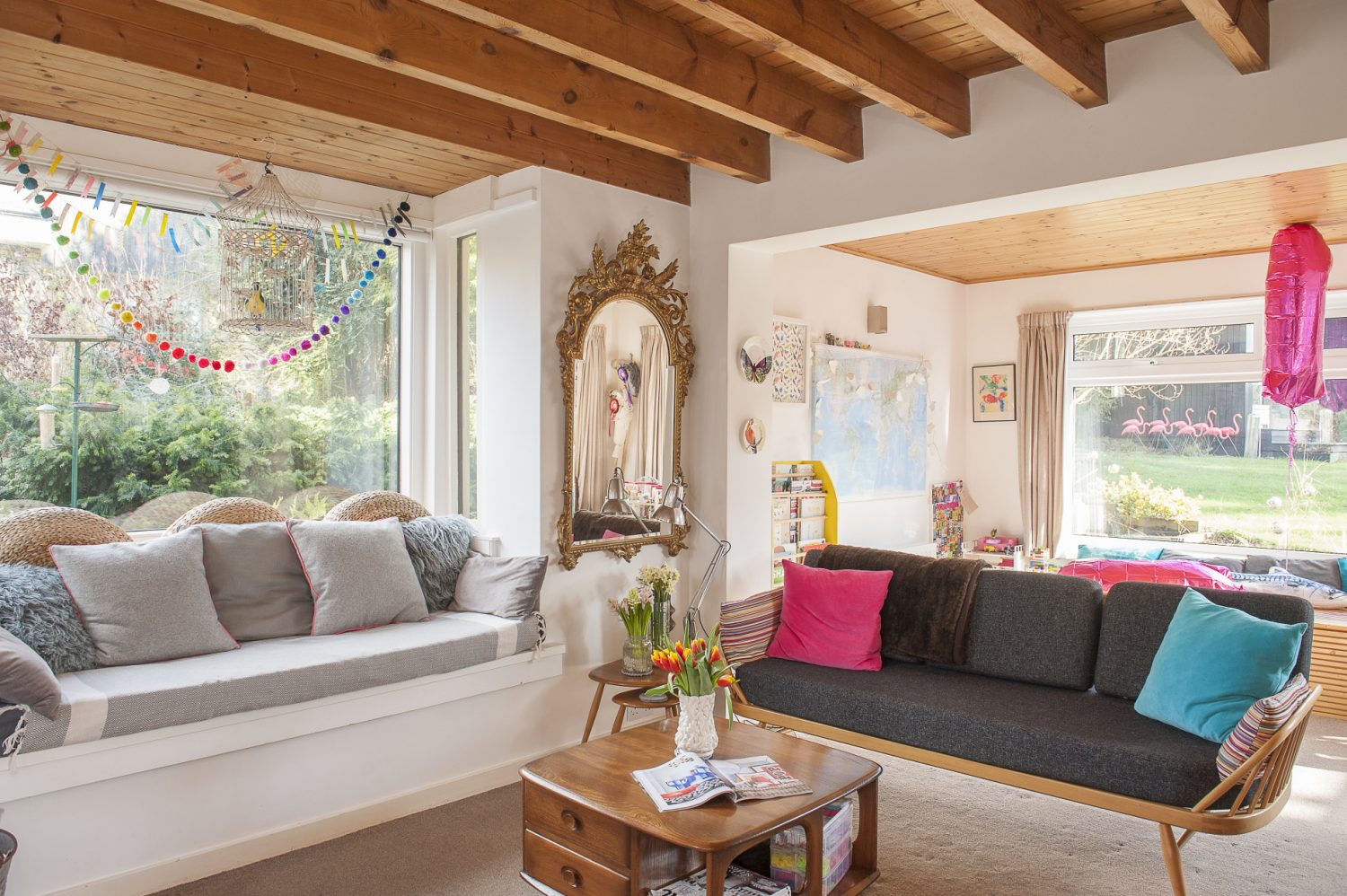 The drawing room looks out into the garden which surrounds it, complete with a flock of vibrant pink plastic flamingos