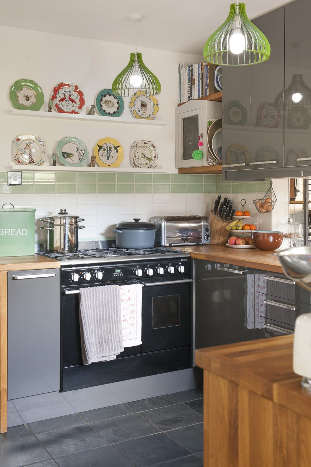 In the kitchen there's an eclectic mix of items including a collection of Lou Rota plates featuring bugs, bees and birds that Sam found in Anthropologie