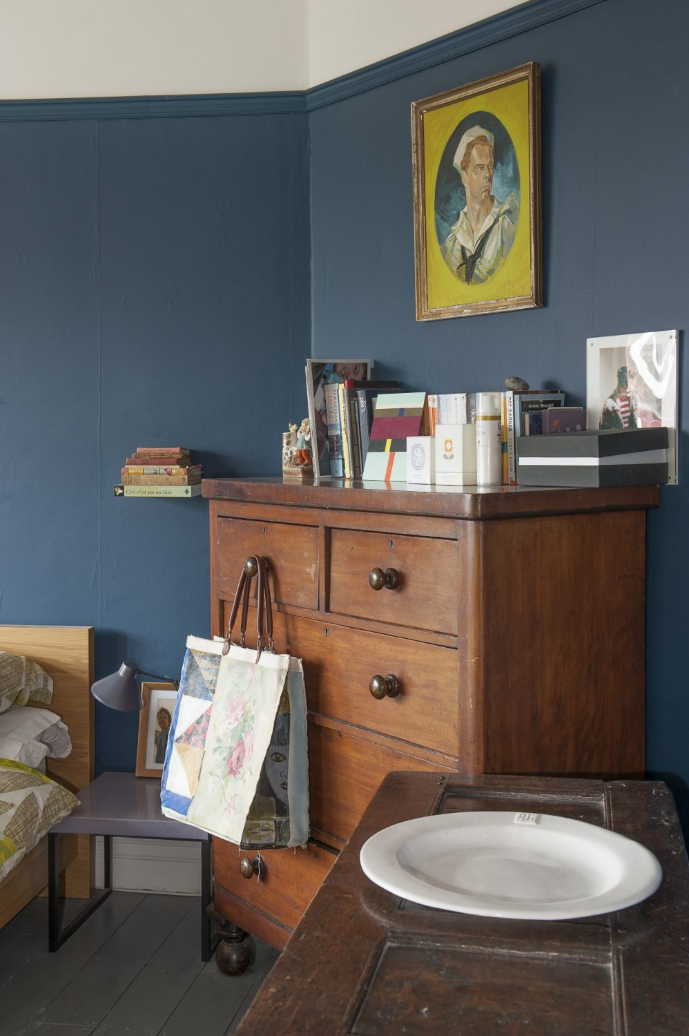 Anna's bedroom is home to one of the few pieces of dark wood furniture in the house – a very serious and beautiful Jacobean chest which once belonged to her grandmother