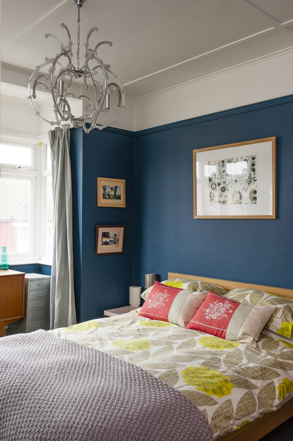 Anna's bedroom is flooded with light which has allowed her to opt for rich, dark walls without compromising a bright and airy space