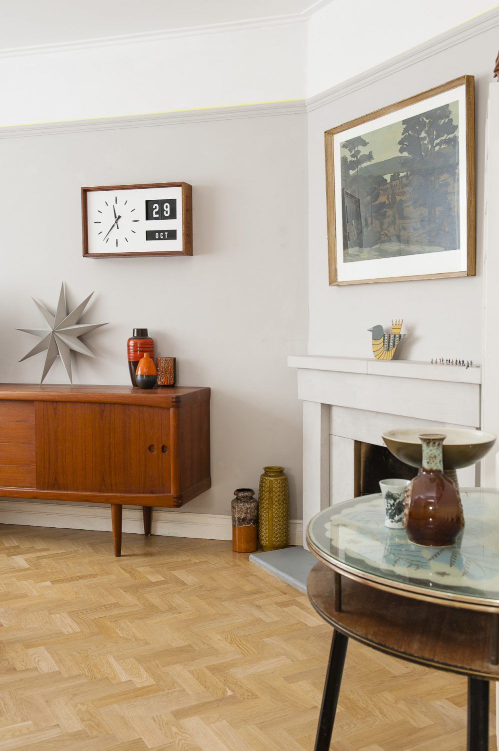 Above a spectacular mid-60s sideboard hangs a 60s bank clock showing both time and date