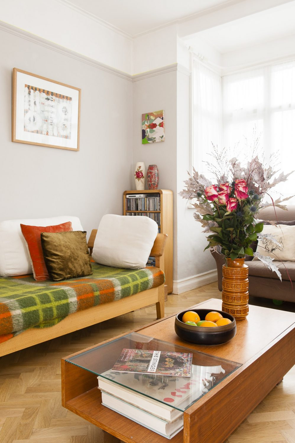 The half-glass coffee table is from Habitat as are the two sofas