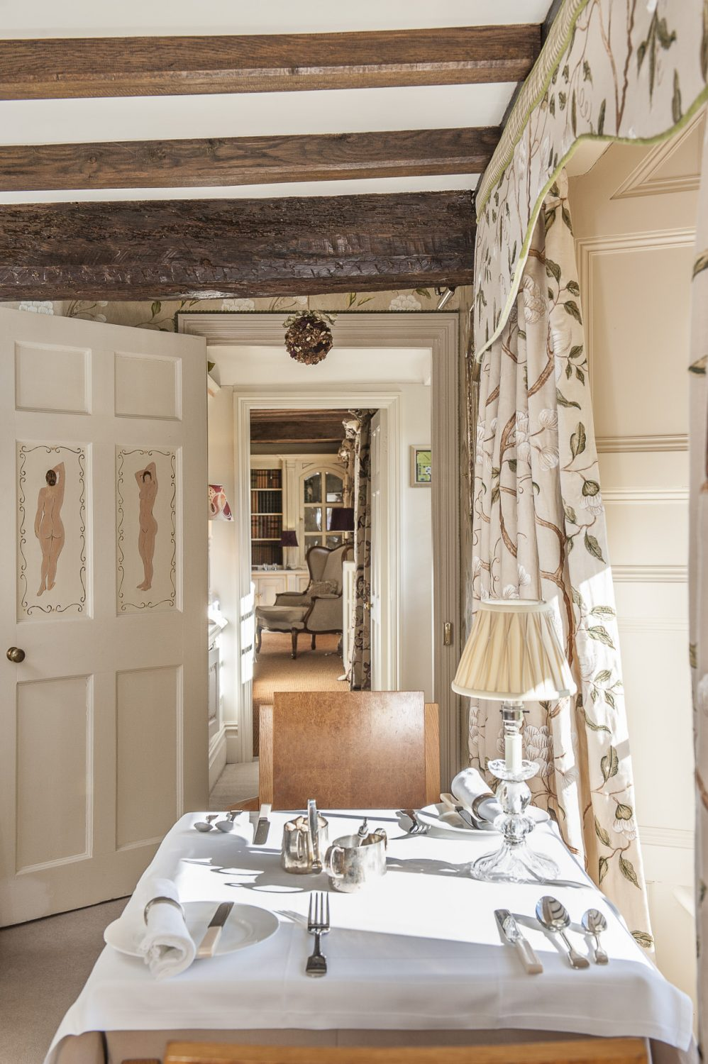 On the doors leading through to the garden and drawing room are two hand-painted nudes, Nina's tribute to Charleston
