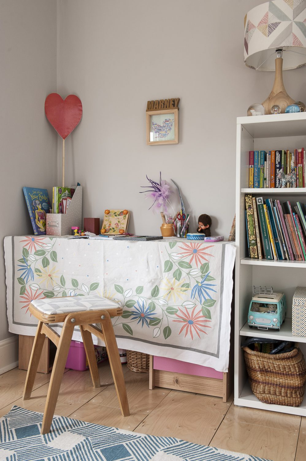 Daughter Marney's room. The picture over the desk was a birthday gift from a friend. The perspex 'illusion table' by the bed is by Essey and was bought online ten years ago. The cushions on the bed are Louise's designs. The print of The Tiger Who Came to Tea was free in The Times and Louise had it framed