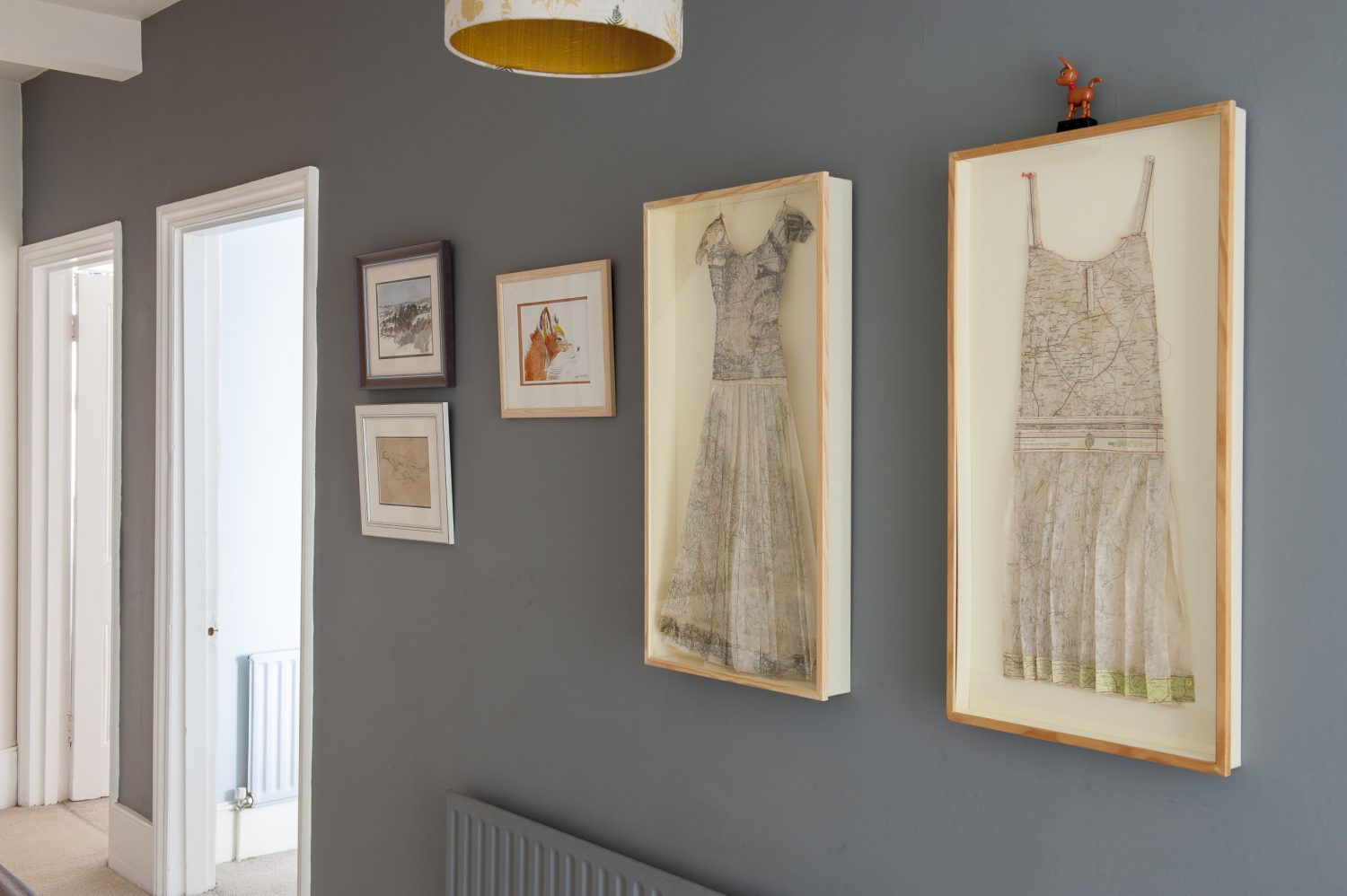 On the landing. Louise made the paper dresses out of old maps