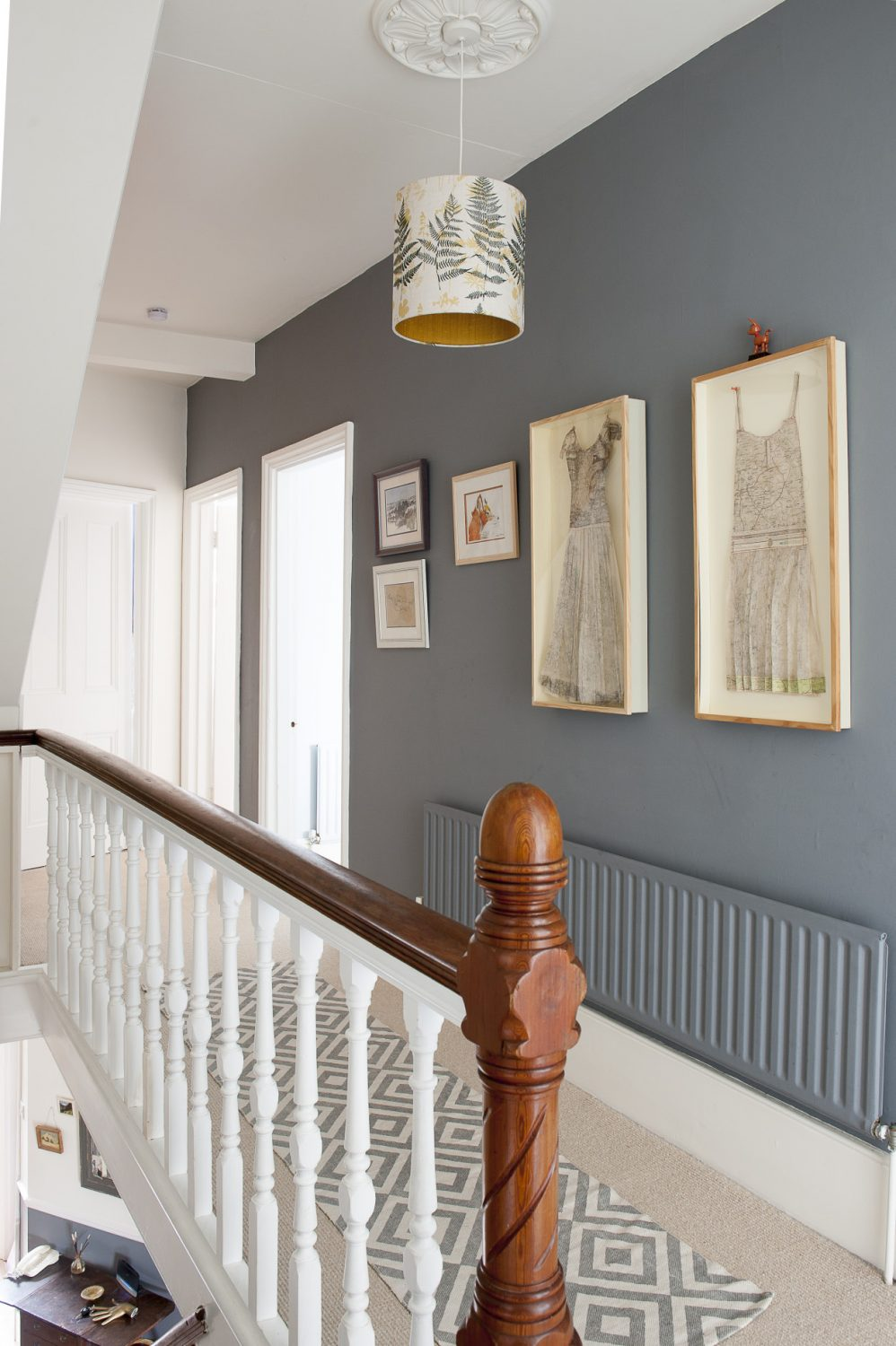 The landing wall is painted in Downpipe by Farrow & Ball. The lampshade is Louise's design
