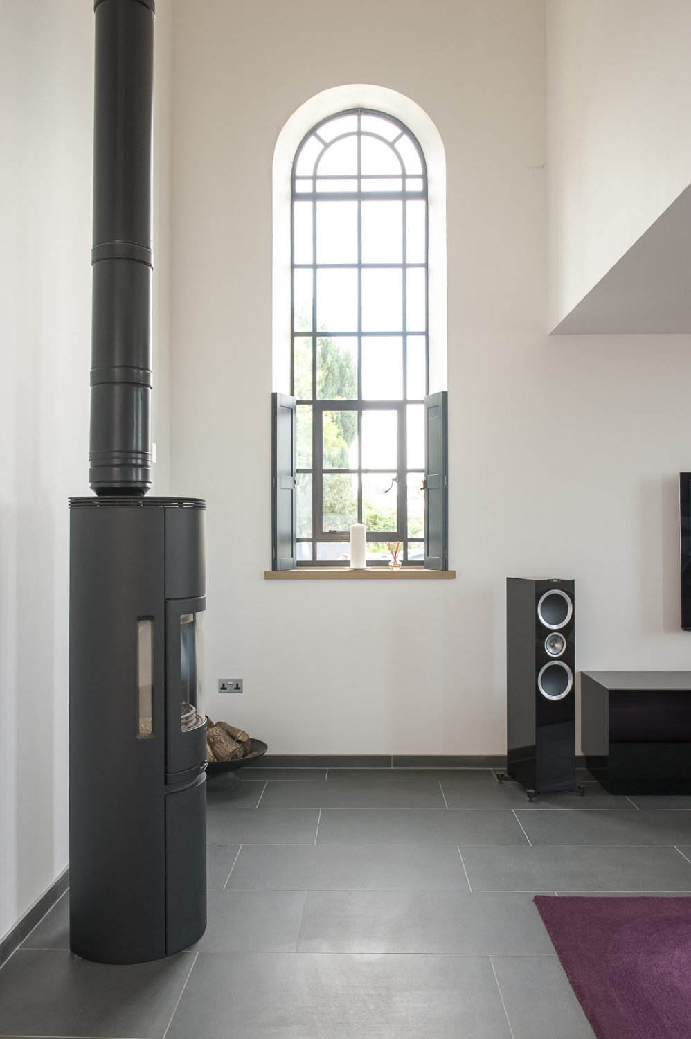 At one end of the room is a contemporary Contura woodburner, the tallest that Nick and Sonja could find