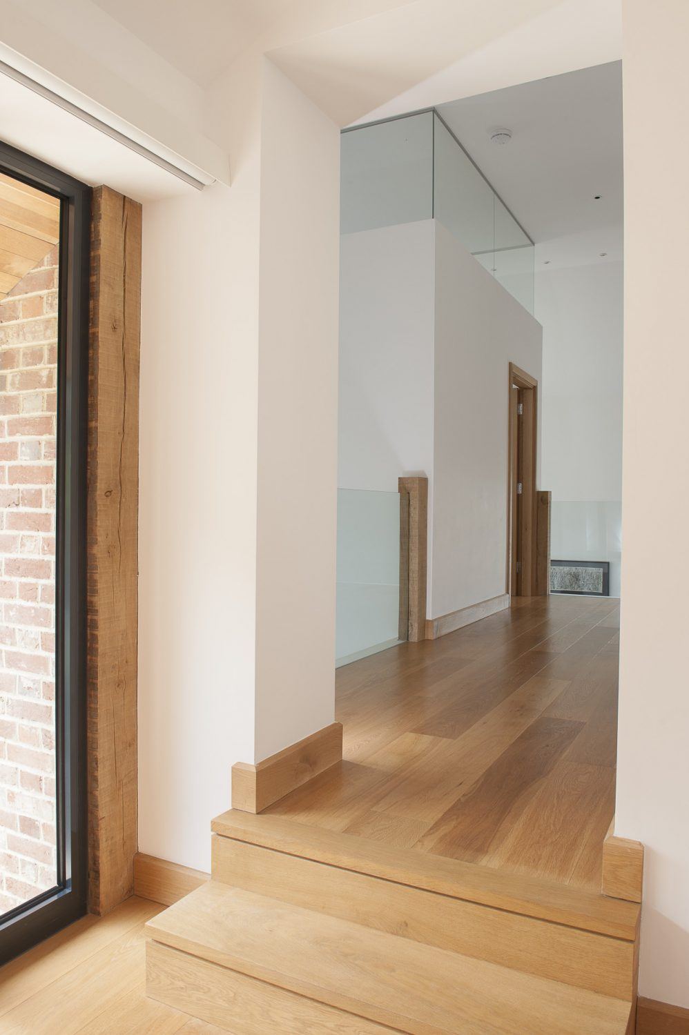 Underfoot – as in most of the chapel – glows warm engineered oak.