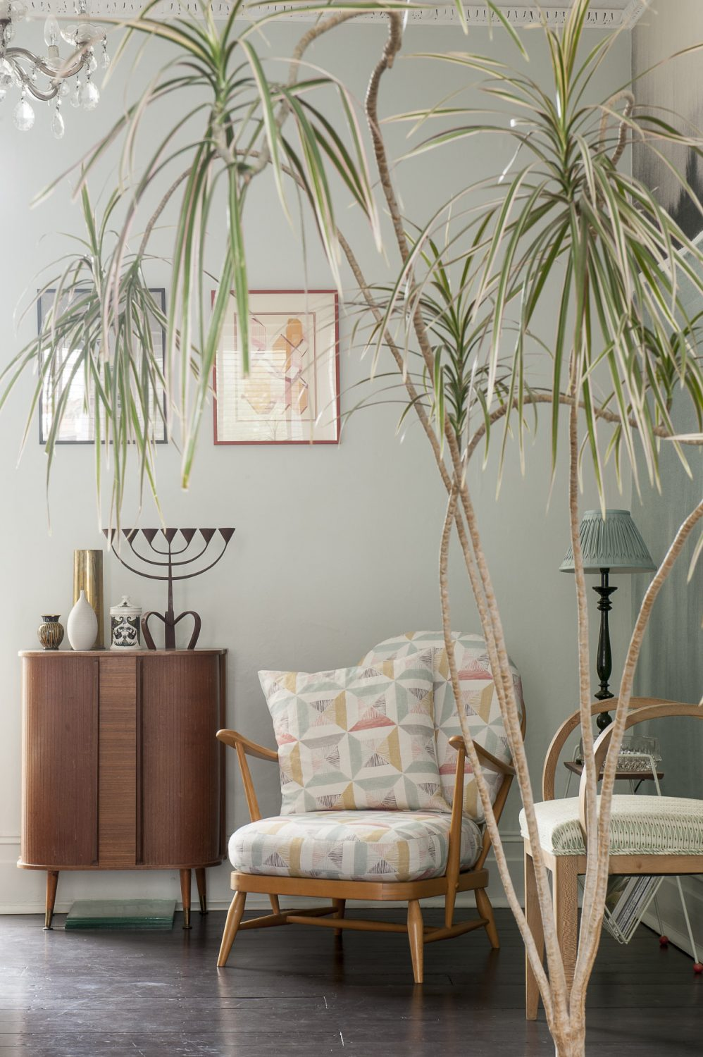 The walls in the dining room are painted in Farrow & Ball Pale Powder. The drinks cabinet was £16 from Courthouse Mews reclamation yard in Hastings Old Town, the menorah was from another Hastings antique shop. The low armchair by Ercol, covered in Louise's fabric