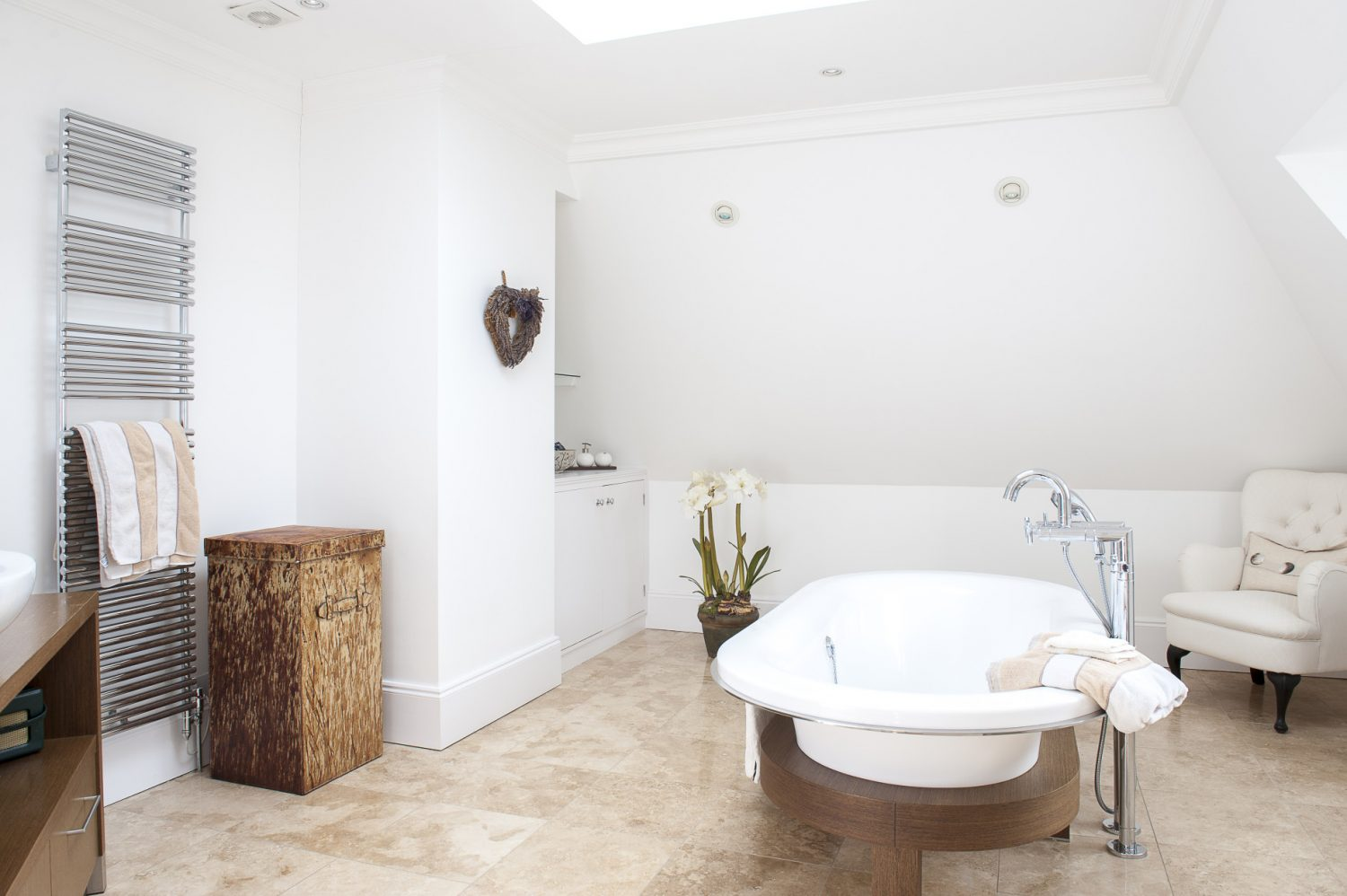 Helena and Julian wanted to be able to lie in the bath and gaze up at the stars, so positioned the double-ended bath under a central skylight window. Underfloor heating and a large heated towel rail keep this generous bathroom warm, even in the depths of winter