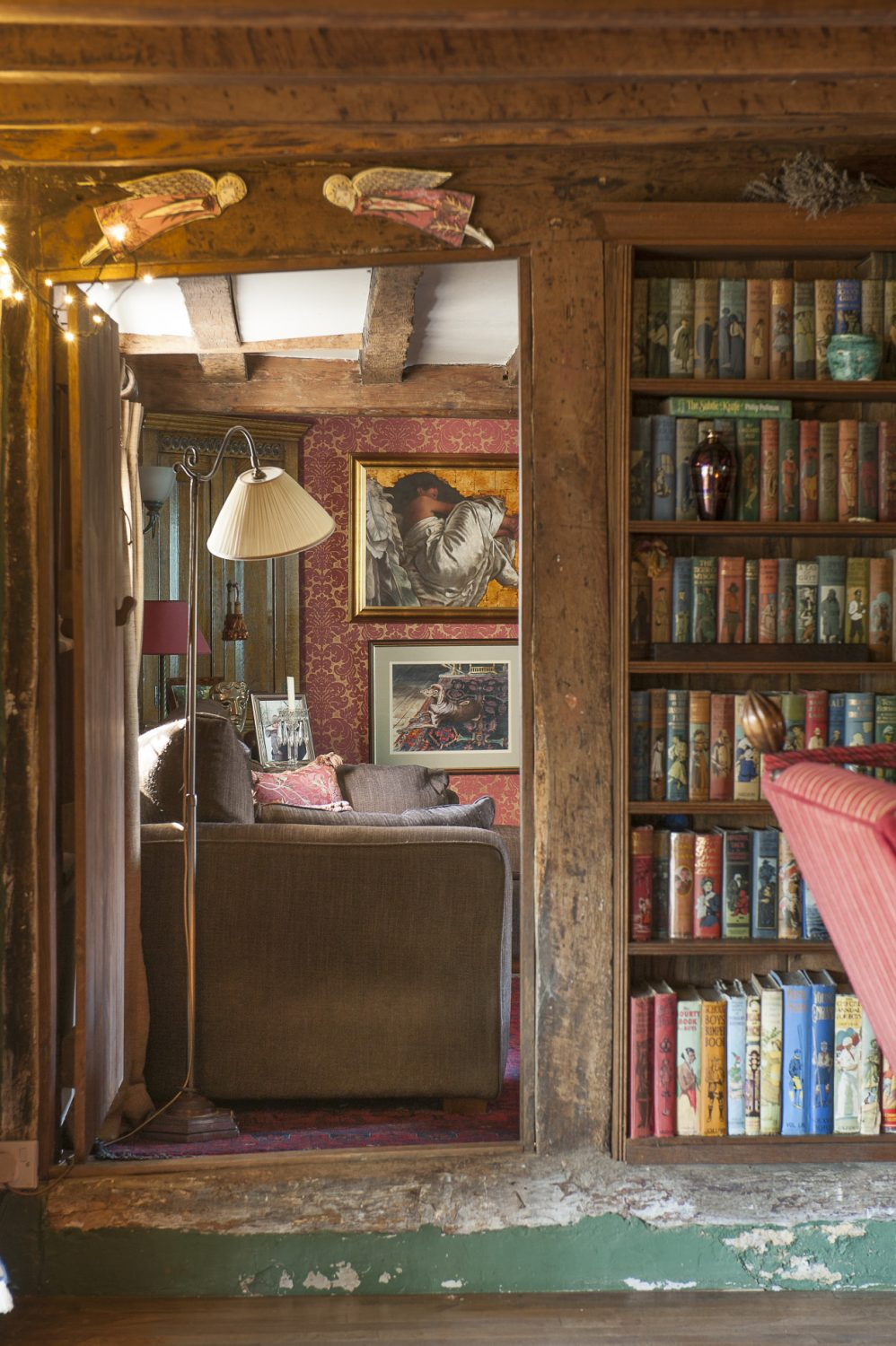 Instead of wallpaper depicting the spines of books, Tim and Eve have a wall of children's books dating from the First World War to the mid 1950s