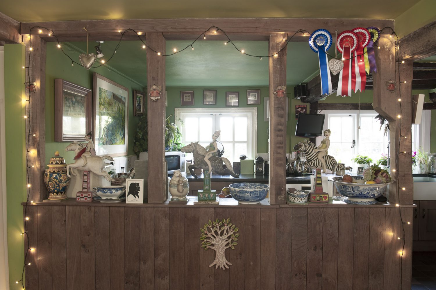 The ladies riding horses and a zebra are by Cranbrook ceramic artist Marie Prett