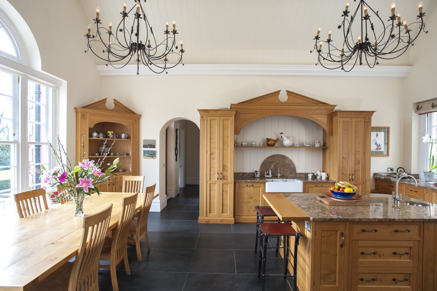 Two fabulous wrought-iron chandeliers, sourced from Illuminations in Tunbridge Wells, are a striking feature in the vast kitchen