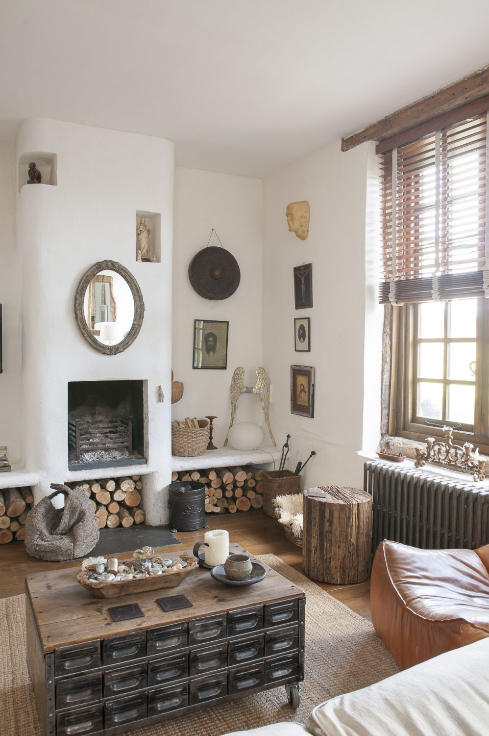 A cosy seating area gathers around a white Moorish fireplace and chimney