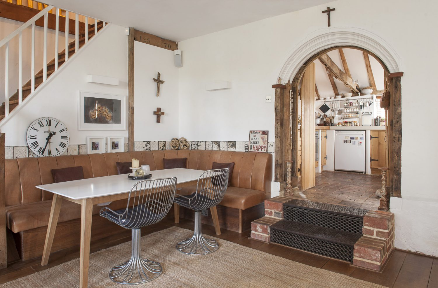 The family/breakfast room divided by a structural beam supported by one of the cast iron pillars that once held up a roof in Tenterden's Victorian railway station
