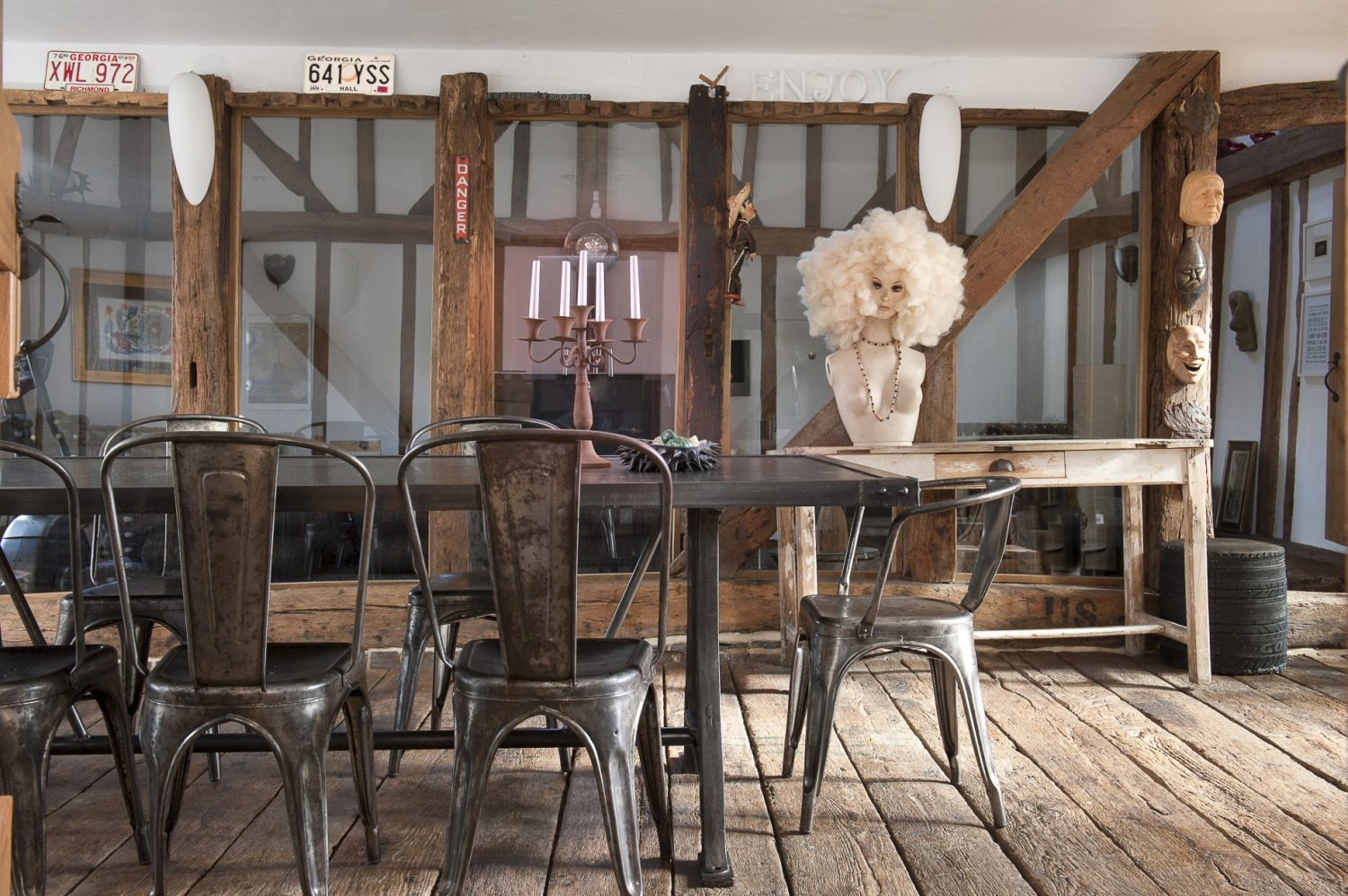 Centrepiece of the heavily timbered dining room is a truly spectacular industrial steel dining table and chairs, made from reclaimed metal by Le Grenier in Lille