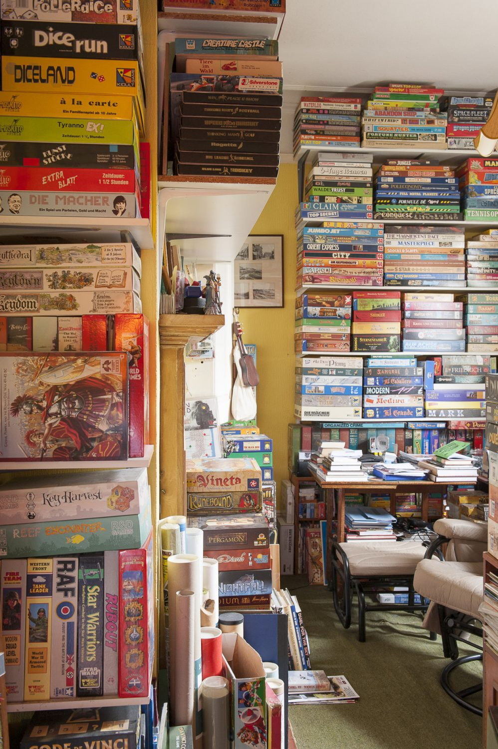 Mick's study is packed from floor to ceiling with his collection of board games