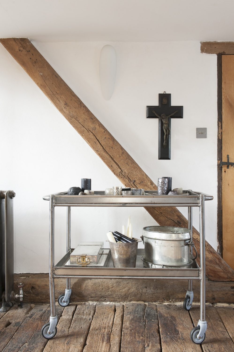 """Part of Lorraine's collection of crosses hangs above a metal trolley, """"I'm not religious in the slightest,"""" says Lorraine, """"I just like crucifixes."""""""