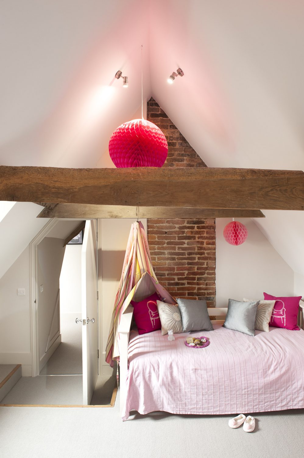 """The attic, once converted, was the perfect space for three children's bedrooms. """"We renovated the first two floors of the house first,"""" says Perrine, """"and then had to wait while we got planning permission for our plans for the top floor."""" Thankfully, approval was granted, and the children now love their cosy rooms"""