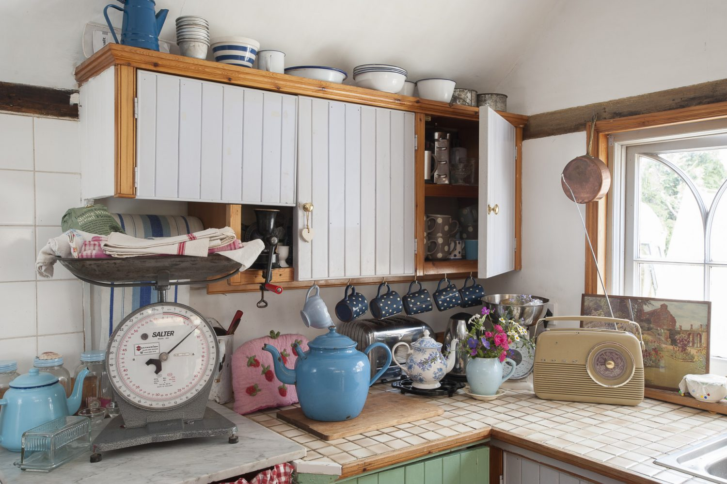 Whilst they wait to start work on their new extension, Pippa and Mike have settled into the existing kitchen, where generously stocked shelves ensure that ingredients and cookbooks are always conveniently to hand