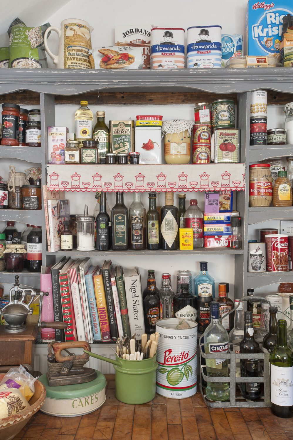 generously stocked shelves ensure that ingredients and cookbooks are always conveniently to hand