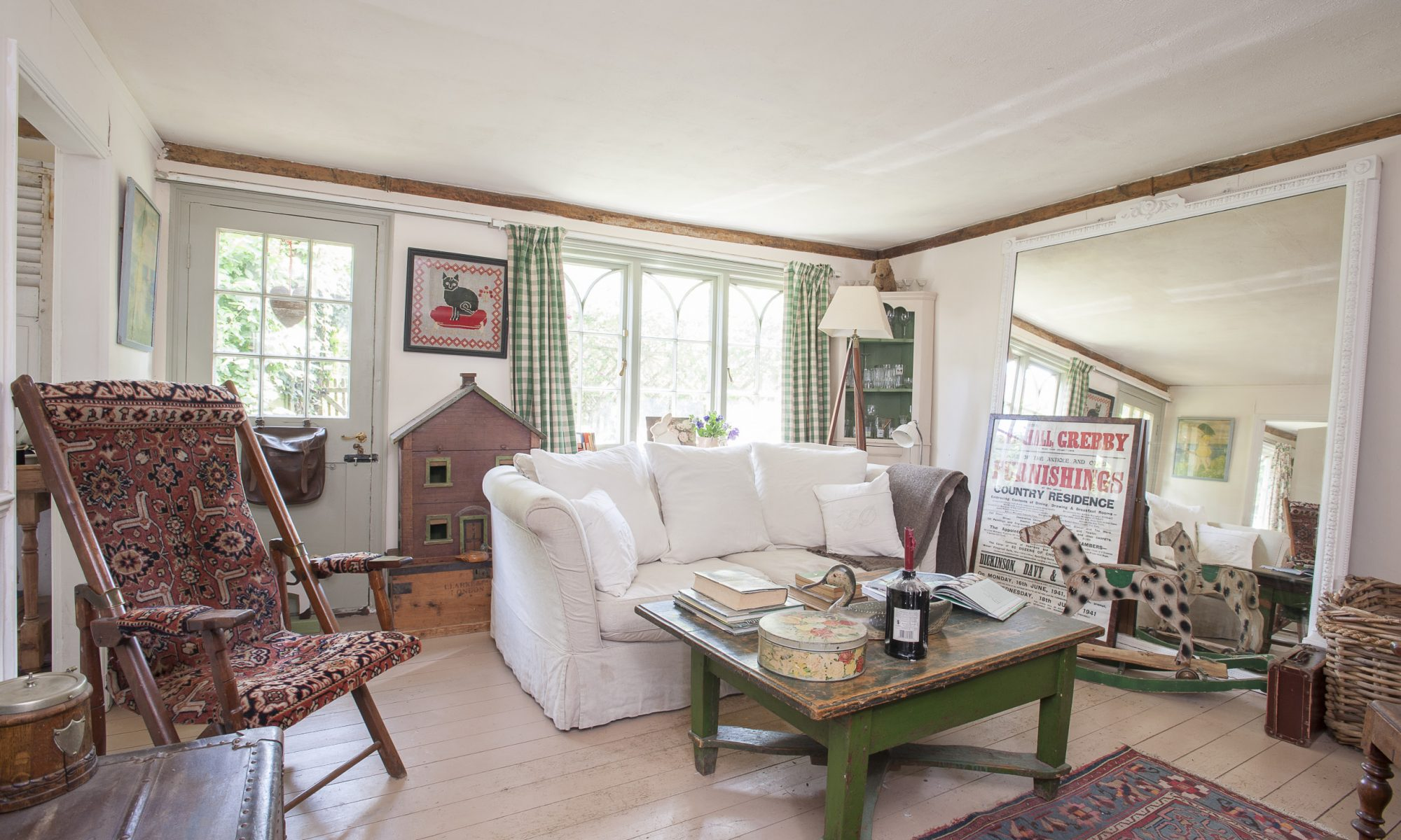 """The feeling of space is enhanced by the enormous mirror in the sitting room, that despite its size – """"People said we'd never get it in,"""" Pippa laughs – works really well"""