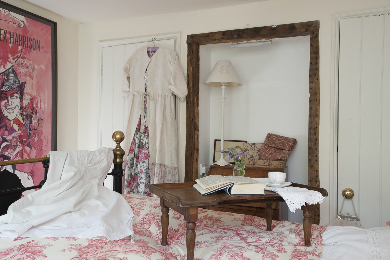 A door from the sitting room leads into the master bedroom. The couple have plans to extend the cottage outwards and upwards, adding on more living space and a further bedroom upstairs