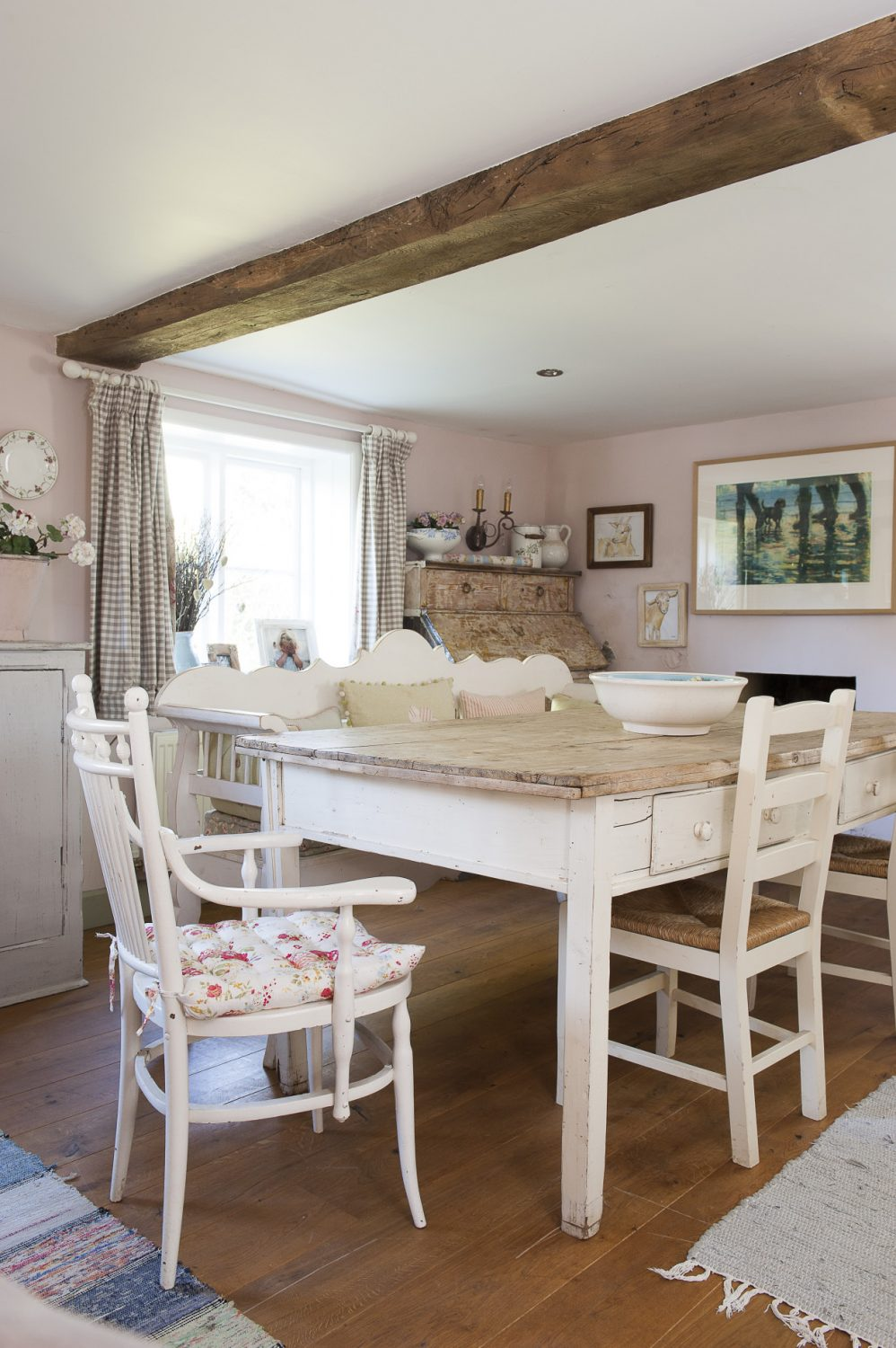 Caroline is a regular visitor to the Ardingly antiques market, where she bought this large, French-style farmhouse table and other accessories that decorate the large living area at the front of the house