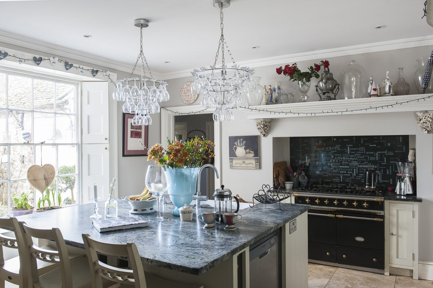 Christel loves to cook, but also lets professional chefs use her kitchen when hosting weddings. The impressive mantelpiece was made especially to sit over the Lacanche range cooker – which came from one of David Beckham's houses – and the stone corbels on which it rests, came from an antiques fair