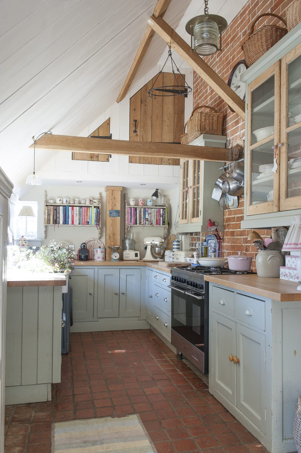 The kitchen sits under the catslide roof at the back of the farmhouse and is made from a host of up-cycled and recycled materials