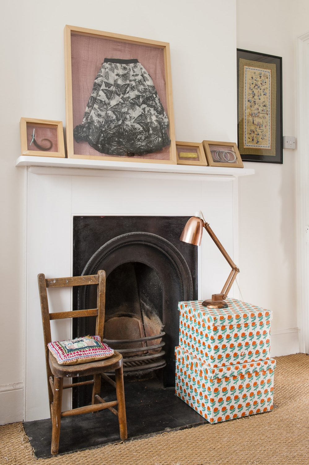 The room that was Rosa's is simply furnished and above the fireplace on the wall there are picture frames containing some of her things. In the centre is the butterfly skirt that Vanessa writes movingly about in her memoir