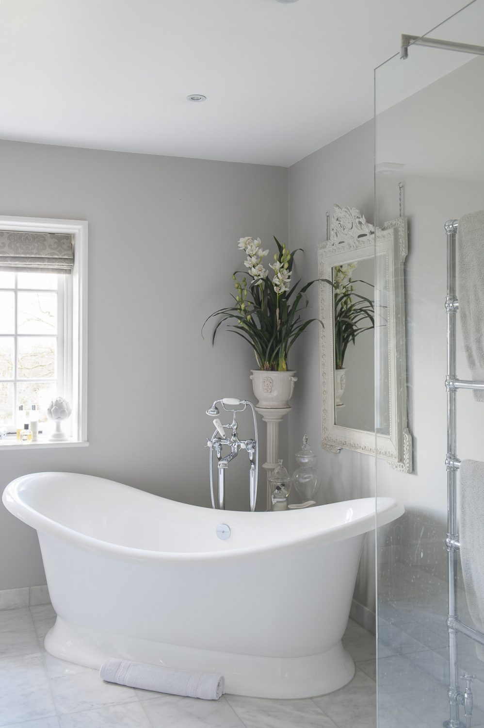 A volcanic limestone double-ended bath is large enough to accommodate Victoria and both children