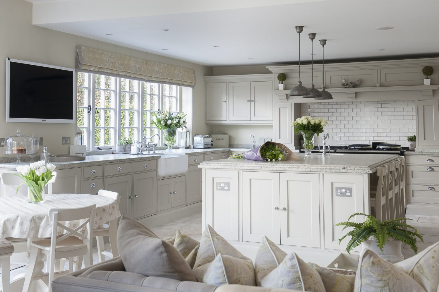 The smartly appointed kitchen inhabits a vast space that was once the garage