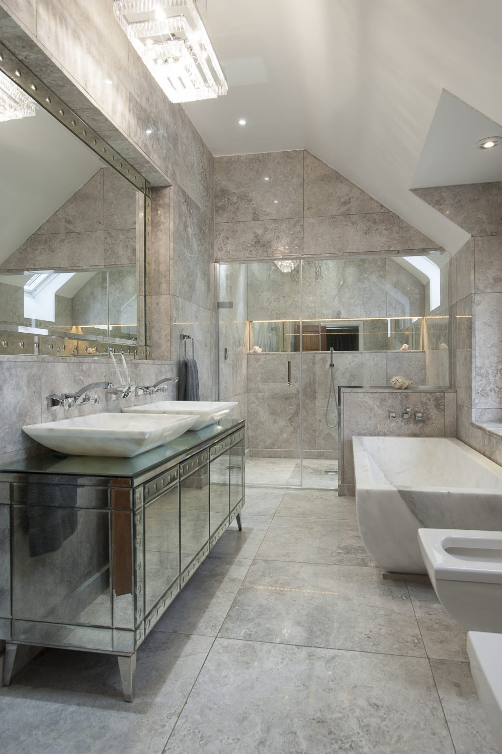 The bathroom with its part-vaulted ceiling is superb, its centrepiece a huge bath cut from a single block of Turkish marble...