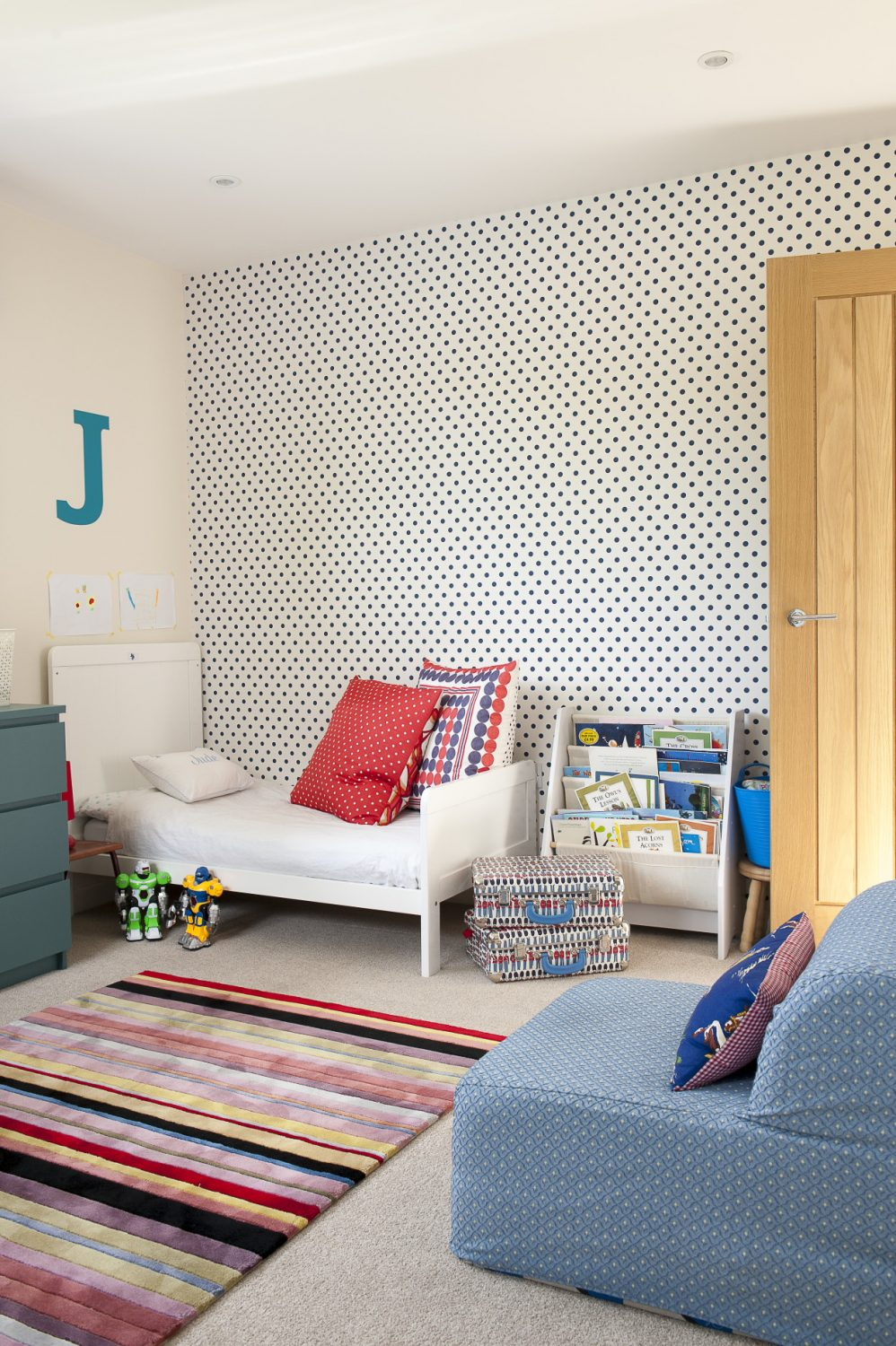 Jenny has papered the twins' room with navy polka dots