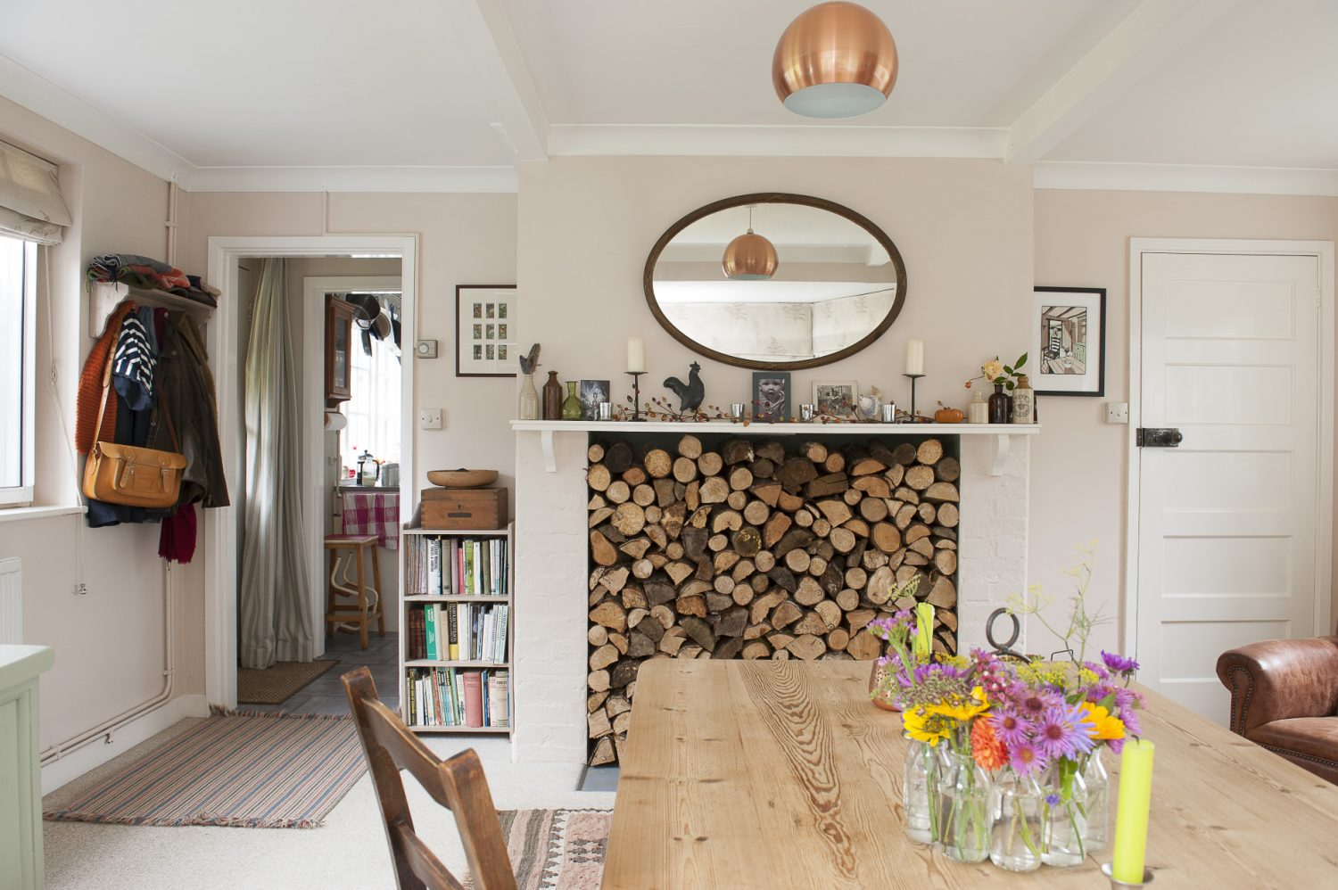 A fireplace which was once home to a kitchen range now acts as the focal point of the front room. A large bay window bathes the room in natural light